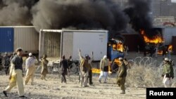Smoke rose from burning supply trucks for NATO forces during a protest in Khost Province on February 24. Protests were continuing the following day.
