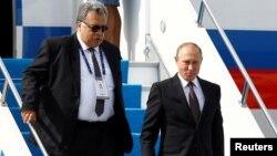 Andrei Karlov Türkiyədə Vladimir Putin-i müşayiət edir.