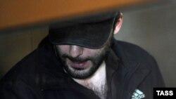 Один из подозреваемых в причастности к теракту в аэропорту Домодедово. Москва, 27 августа 2012 года.