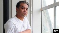 Уйгурский ученый Ильхам Тохти в университете. Пекин, июнь 2010 года. В 2014 году его приговорили к пожизненному лишению свободы.