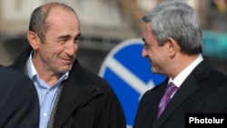 Armenia - President Serzh Sarkisian (R) and his predecessor Robert Kocharian at an official ceremony near Yerevan, 03Dec2008.