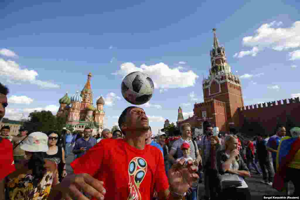 A Moroccan soccer fan plays with a football on Moscow's Red Square after his country's World Cup match with Portugal on June 20. (Reuters/Sergei Karpukhin)