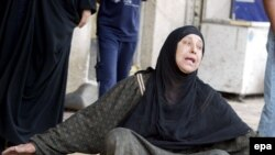 An Iraqi woman weeps at the site of a suicide attack in Baghdad's Karrada district on April 23.