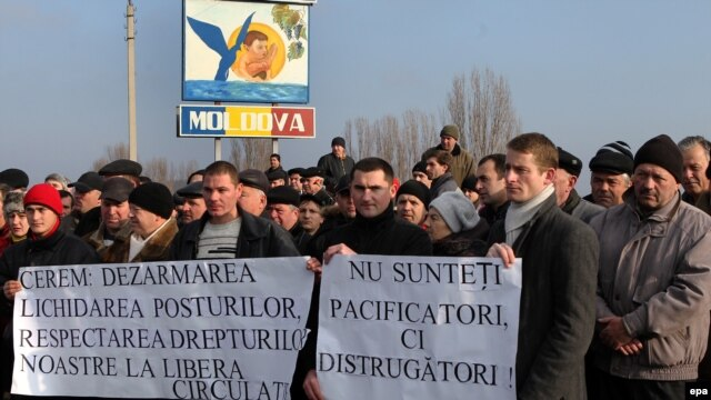 Demonstrators in Moldova call for the removal of checkpoints controlled by  Russian troops after the fatal shooting of an 18-year-old man at the Vadul Iui Voda checkpoint on January 1.