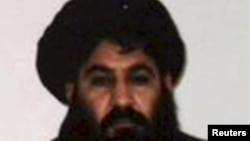 Mullah Akhtar Mohammad Mansur, Taliban militants' new leader, is seen in this undated handout photograph by the Taliban