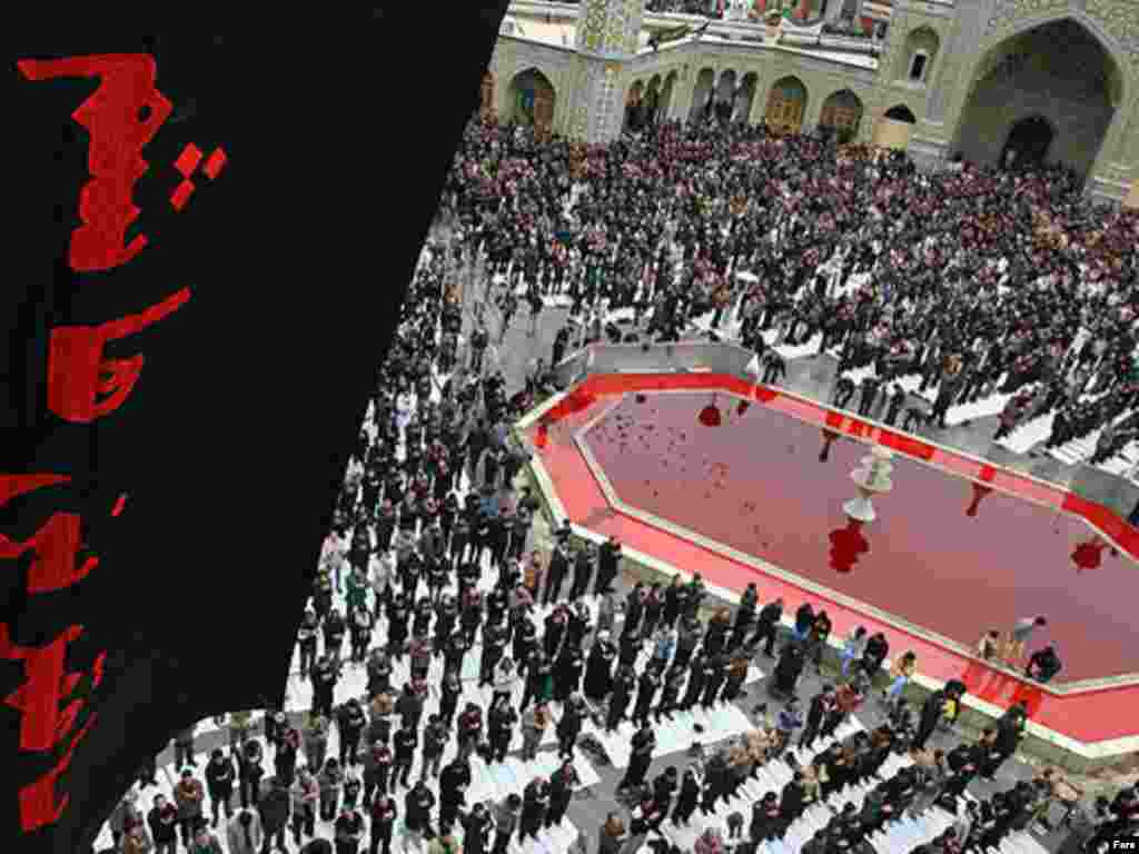 """A """"fountain of blood"""" during Ashura celebrations at a shrine in the Iranian holy city of Qom, a major hub of Shi'ite scholarship."""