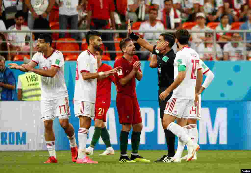 Soccer Football - World Cup - Group B - Iran vs Portugal - Mordovia Arena, Saransk, Russia - June 25, 2018 Portugal's Adrien Silva remonstrates with referee Enrique Caceres as a penalty decision is referred to VAR REUTERS/Murad Sezer