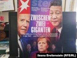 """Revista """"Stern"""" cu titlul """"Între doi giganți"""", prefațând întâlnirea cancelarei Angela Merkel la Casa Albă din 15 iulie 2021."""