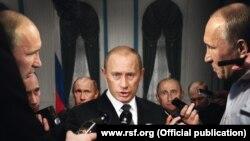 """Плакат организации """"Репортеры без границ"""" под названием """"Путин и много путиных"""""""