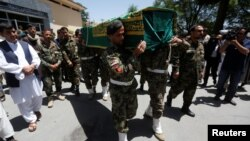 Afghan soldiers carry the coffin of Zabihullah Tamanna, an Afghan journalist who was killed while embedded with local troops last year
