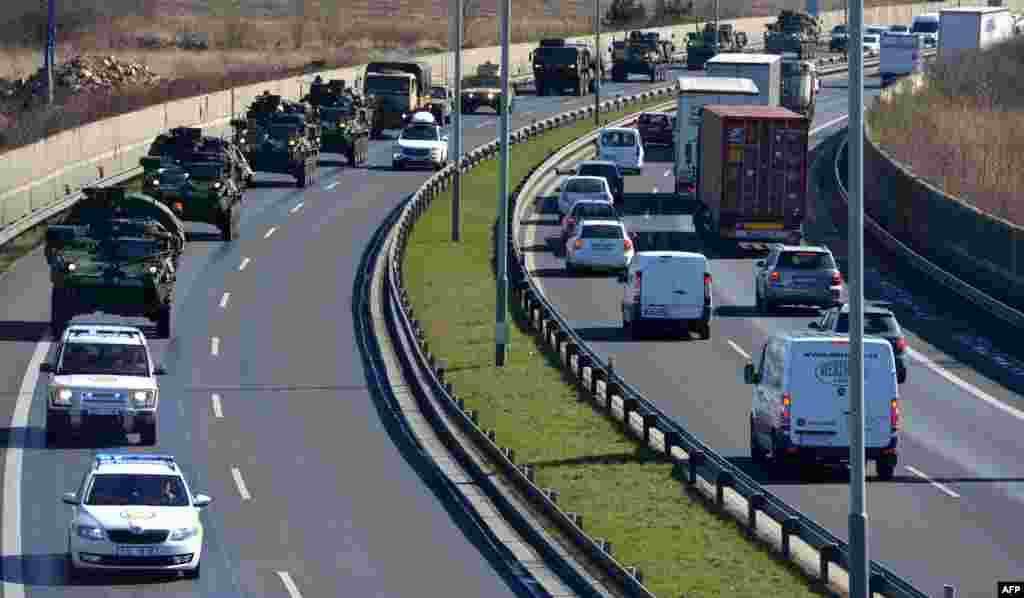 The military convoy rides into Prague.