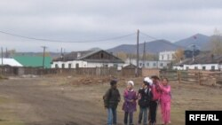 Mongolian children walk home from school in Zuunkharaa, a former railroad and industrial hub 160 kilometers from the capital, Ulan Bator.