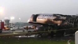 Rusia publică imagini cu avionul distrus de flăcări