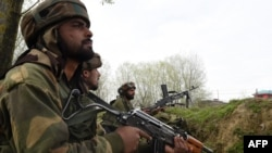 FILE: Indian soldiers look on during clashes between suspected rebels and Indian forces in Badgam district south of the regional capital Srinagar.