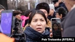 Inga Imanbai talks to reporters in Almaty on February 22.