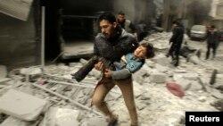 Алеппо, північ Сирії, 21 січня 2014 року – за словами опозиції, фото зроблене після чергового повітряного удару урядових військ