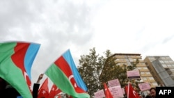 Protesters wave Azerbaijani flags during a demonstration against Turkish relations with Armenia near the Ataturk Stadium in Bursa on October 14.