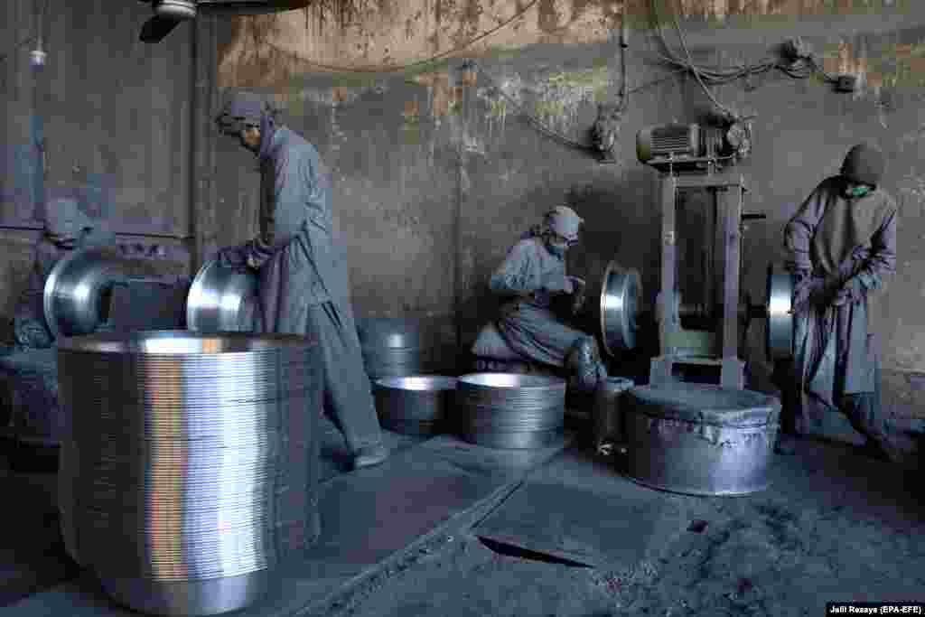 Laborers work at an aluminum factory in Herat, Afghanistan. (epa-EFE/Jalil Rezayee)