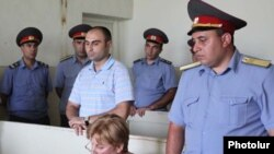 Armenia -- Ashot Harutiunian, a police officer, at the start of his trial on charges stemming from the April 13 death of a man in police custody, 6July 2010.