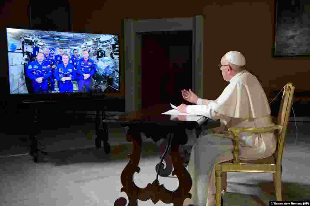 Pope Francis speaks to the crew aboard the International Space Station from the Vatican on October 26. (L'Osservatore Romano/Pool Photo via AP)