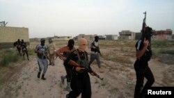 Иракта соғысып жүрген содырлар.
