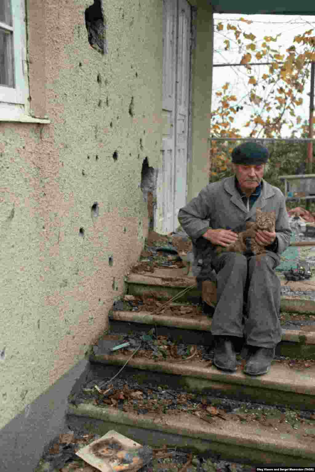 A civilian outside his bullet-pocked home. As the fighting dragged into winter, bands of gunmen prowled rural Abkhazia, terrorizing villages in the now lawless region.