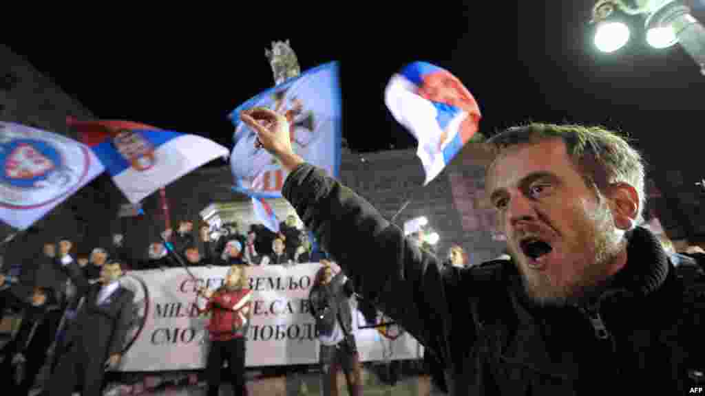 A Serbian ultranationalist shouts slogans during a protest rally in Belgrade after a UN court cleared Kosovo's former Prime Minister Ramush Haradinaj of war crimes committed during the 1998-99 conflict. A UN war crimes court cleared Haradinaj of murder and torture during the 1990s war of independence, enraging Belgrade with the second such acquittal in two weeks. (AFP/Alexa Stankovic)