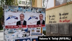 Campaign posters line streets, as the first early parliamentary elections begin in Kosovo.