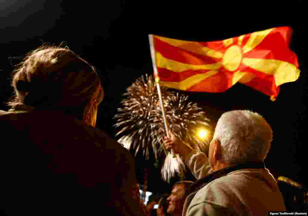 Supporters of the ruling Social Democratic Union wave a Macedonian flag during victory celebrations for the local elections in Skopje on October 16. (Reuters/Ognen Teofilovski)