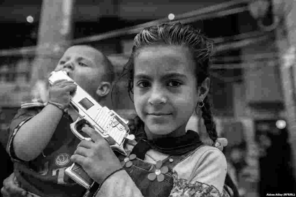 These children are accompanying their parents on a visit to holy shrines in Karbala, but their attention is elsewhere.