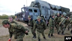 Soldiers near an S-300 surface-to-air missile complex during joint Russian-Belarusian military exercises in September 2009