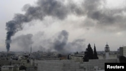Black smoke rises near Homs after oil pipeline hit on February 15.
