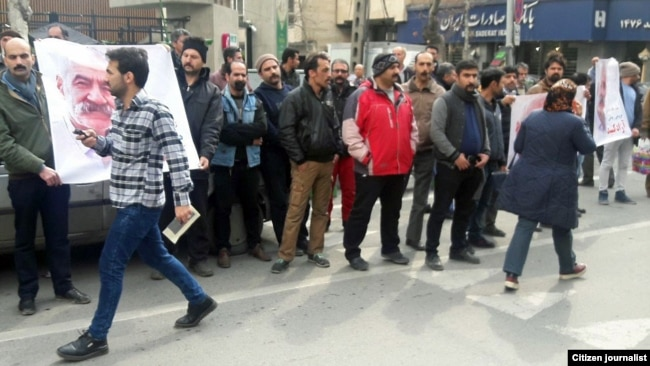 Gonabadi Dervishes gather outside a Tehran police station on February 19 to protest the arrest of one of their number, Nematollah Riahi, 72, who they said had come to the city to help protect Nurali Tabandeh and his home.