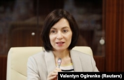 Maia Sandu attends a first meeting of the new cabinet in Chisinau on June 10.