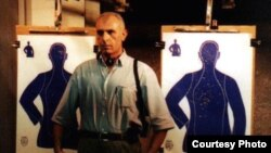 Isakhan Ashurov, pictured here at a Miami police academy during a 2002 visit to the United States, routinely receives death threats because of the controversial nature of the cases he takes on.