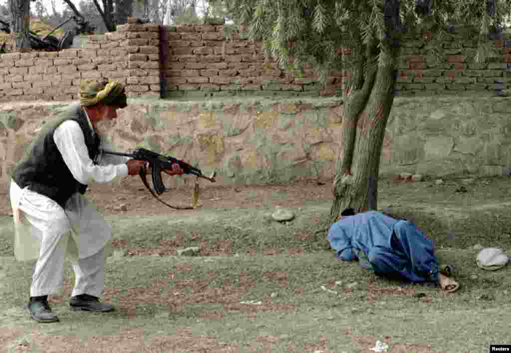 Shirin Khan executes a man who had reportedly killed Khan's son in the town of Khost after a decree handed down by a Shari'a court in 1998.