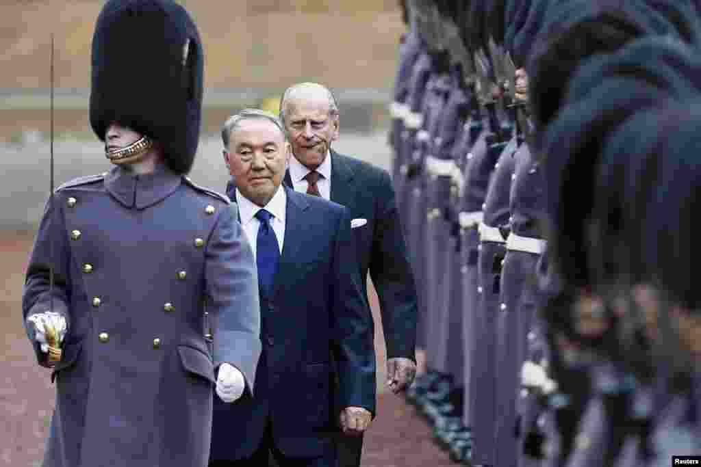 Kazakh President Nursultan Nazarbaev (second-left) and Britain's Prince Philip (third-left) review a guard of honor at Buckingham Palace in London on November 4. (Reuters/Stefan Wermuth)