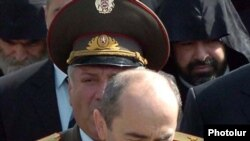 Grigori Sarkisian stands behind then-President Robert Kocharian during an official ceremony in Yerevan in this undated photo.