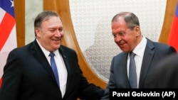 Russian Foreign Minister Sergei Lavrov (right) welcomes U.S. Secretary of State Mike Pompeo for talks in the Black Sea city of Sochi on May 14.