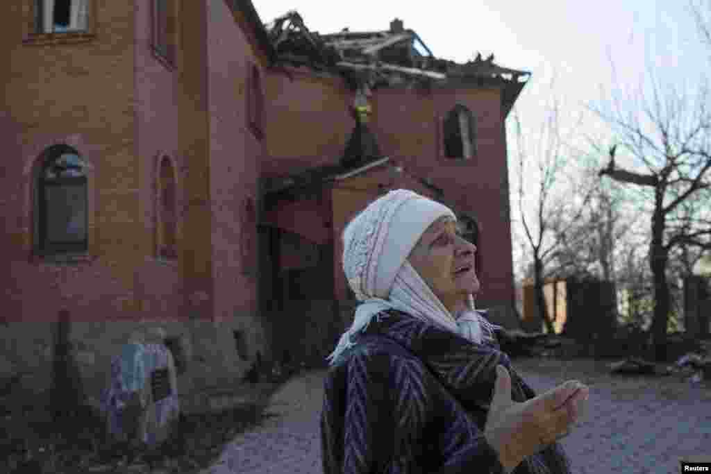 A woman looks at a damaged church in the eastern Ukrainian city of Donetsk's Oktyabrski district. (Reuters/Marko Djurica)