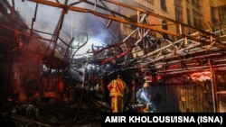 First responders search for survivors at the scene of an explosion at the Sina At'har health centre in the north of Iran's capital Tehran northern Tehran on June 30, 2020. -