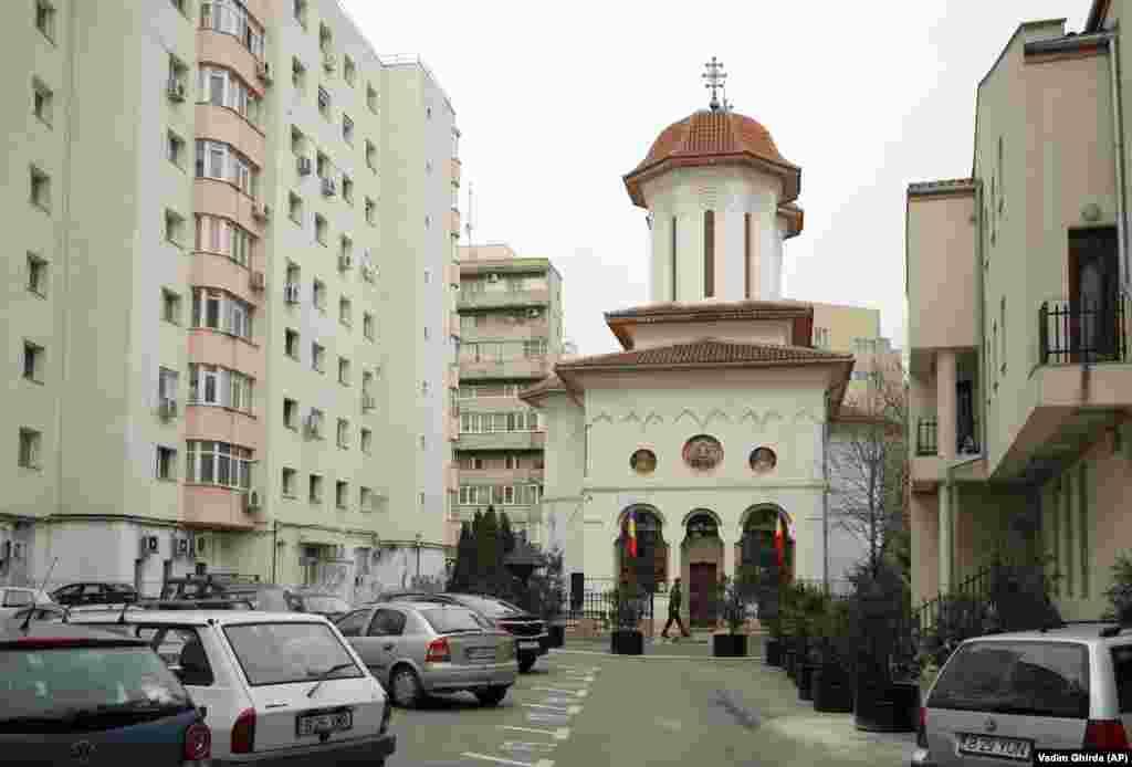 A man walks past Olari Orthodox Church on January 6, 2019.