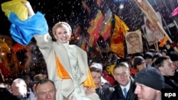 Former Ukrainian Prime Minister Yulia Tymoshenko in happier days at a rally in Kyiv in 2005 (file photo)