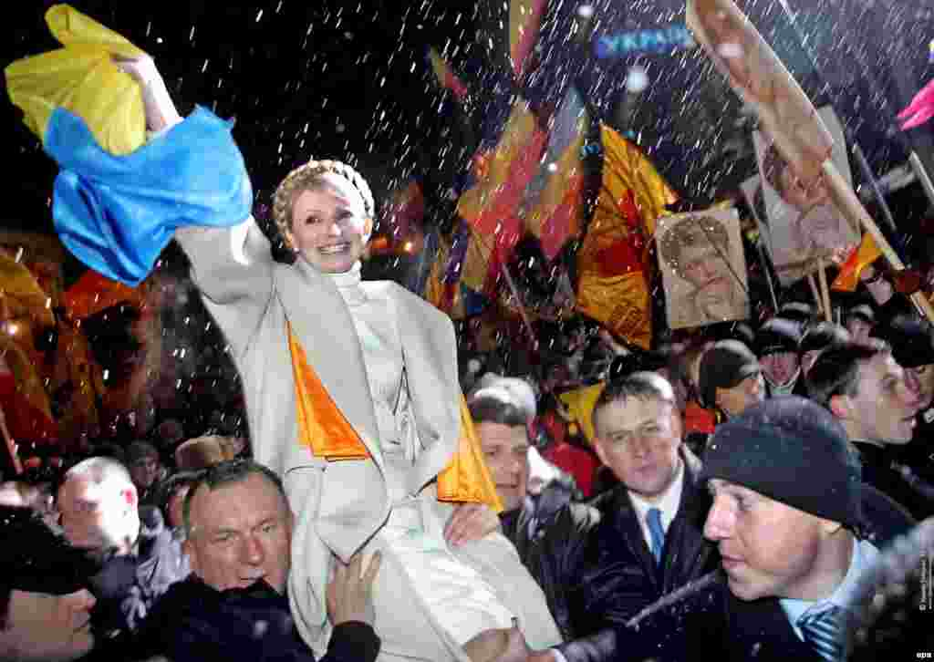 Yulia Tymoshenko's supporters carry her during a massive rally in Kyiv in November 2005 to mark the first anniversary of the Orange Revolution.