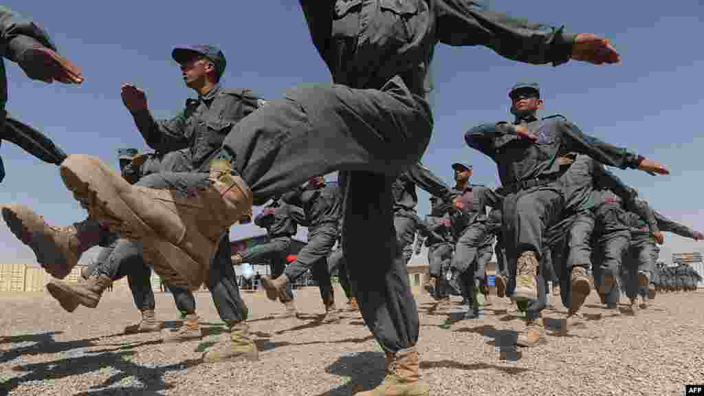 Afghan National Police march during a graduation ceremony at a police training center in Herat. (AFP/Aref Karimi)