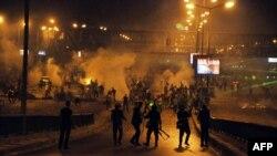 Экс-президент Мұхаммед Мурси жақтастарының полициямен қақтығысы. Каир, 27 шілде 2013 жыл.