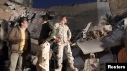 В Триполи разрушаются правительственные здания, но Муамар Каддафи, уверяют союзники, не является целью международной коалиции