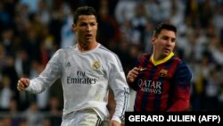 Cristiano Ronaldo, majtas dhe Lionel Messi