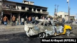 Взорванный в иракском городе Киркук автомобиль. 7 января 2014 года.