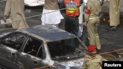 Military personnel secure the site of a suicide bomb attack in Lahore.